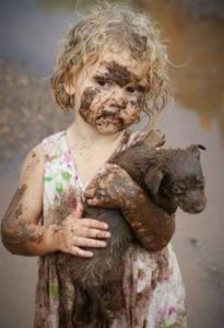 little dirty girl with puppy